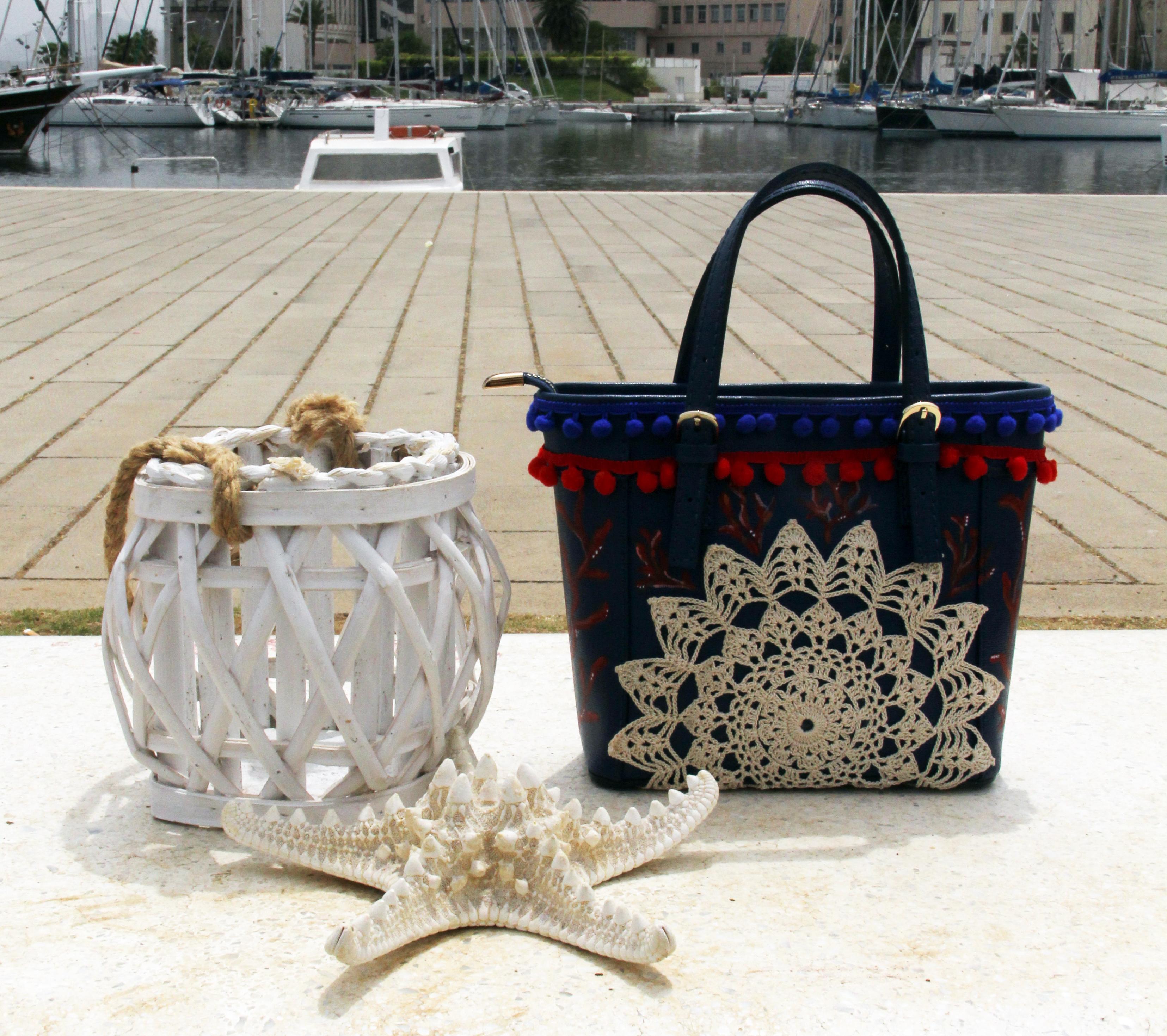 Borsa Tjndara blu merletto e corallo